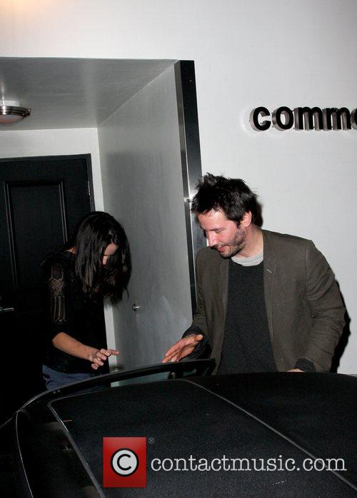 Keanu Reeves leaving Comme Ca restaurant with a...