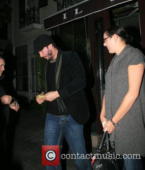 Keanu Reeves and a female friend leaving Il...