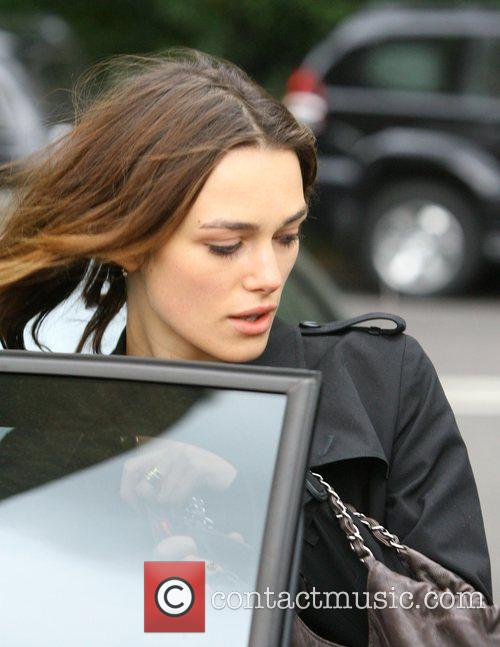 Keira Knightley rushes from her home into a...