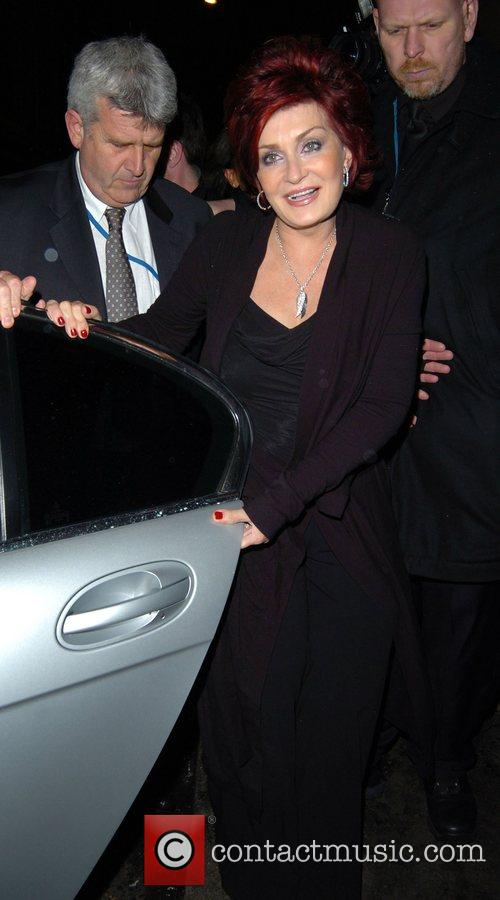 Leaving her daughter Kelly Osbourne's birthday party at...