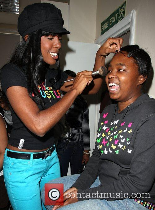 Kelly Rowland makes over local girls as she...
