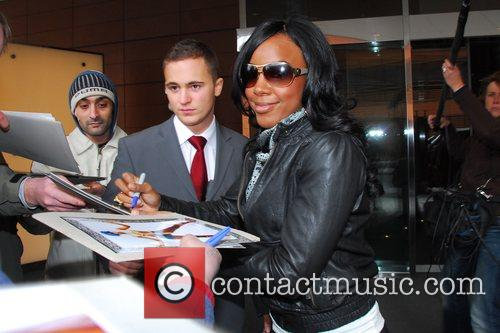 Kelly Rowland  signing autographs whilst leaving Hyatt...