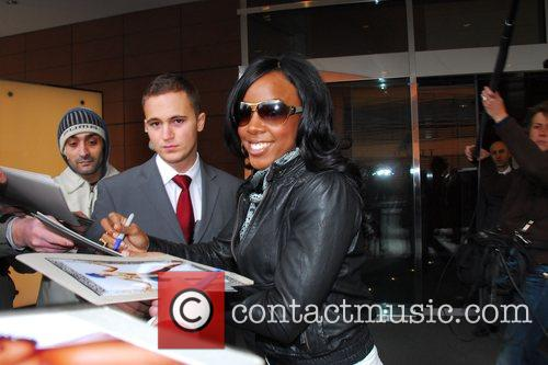 Signing autographs whilst leaving Hyatt Hotel at Potsdamer...