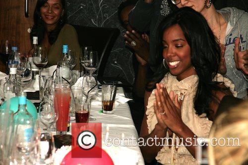Kelly Rowland Blows out the candles on her...