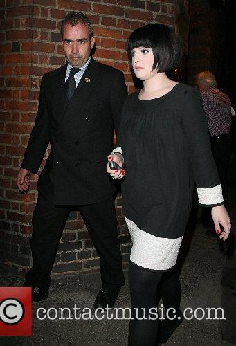 Kelly Osbourne leaving the Cambridge Theatre and signs...