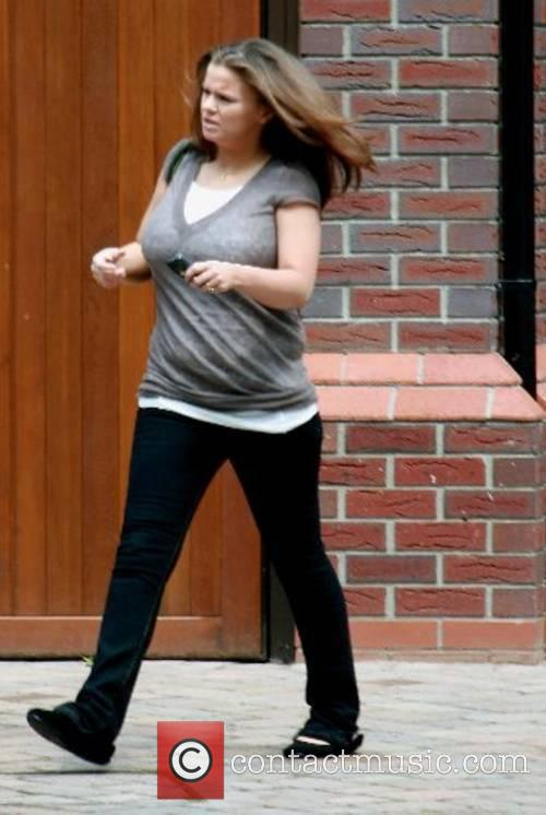 Kerry Katona leaving her house and head off...