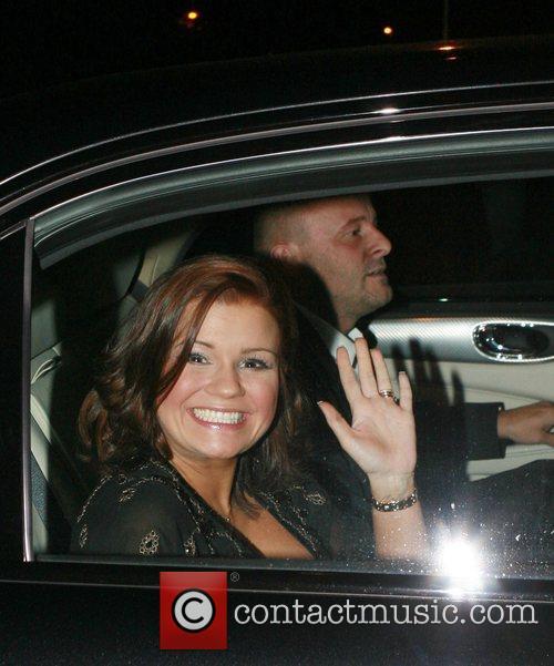 Kerry Katona and husband Mark Croft leaving home...