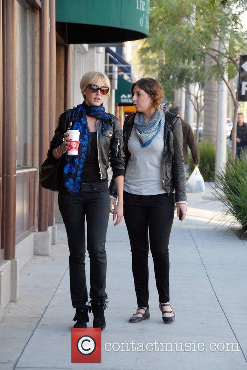 Kimberley Stewart  walking through Beverly Hills with...