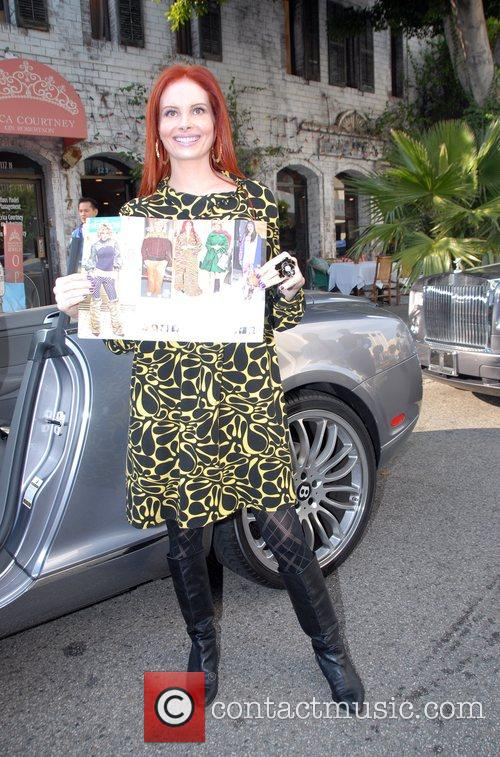 Phoebe Price  showing off a picture of...