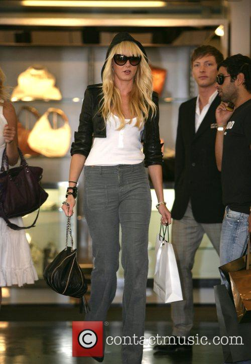 Goes shopping with a friend in Bond Street....