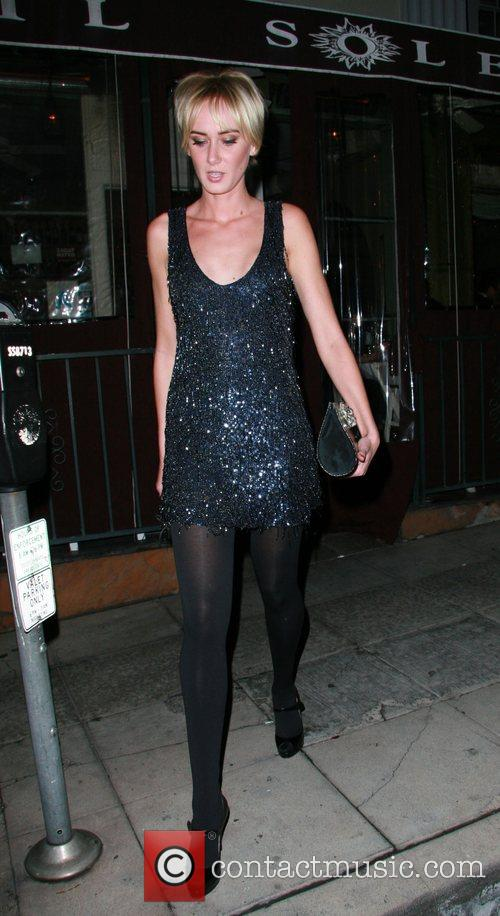 Kimberly Stewart leaving Il Sole restaurant after having...
