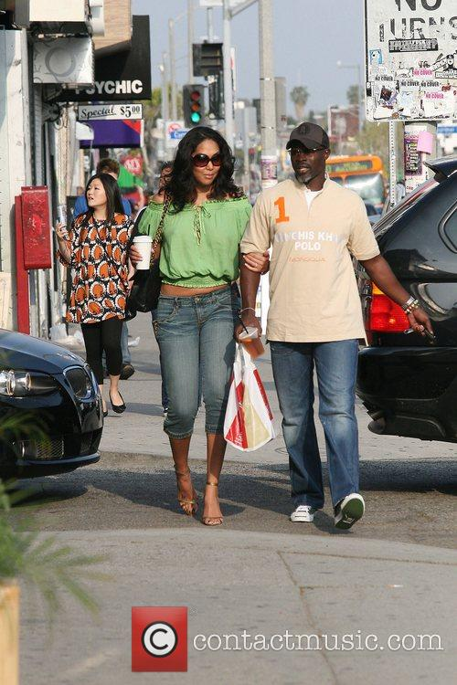 Kimora Lee and her boyfriend Djimon Hounsou shopping...