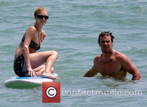 Paris Hilton prefers to sit and pose on...