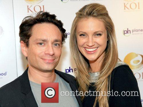 Chris Kattan and guest KOI restaurant opening at...