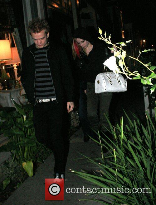 Deryck Whibley and Avril Lavigne arriving at Koi...