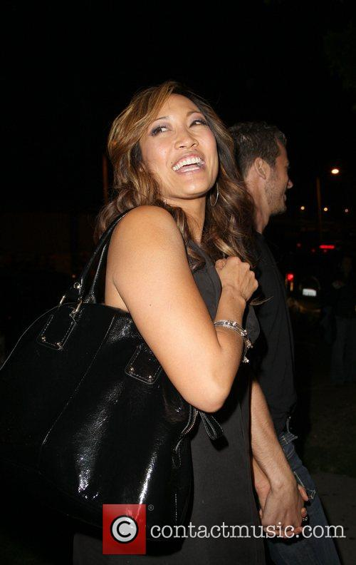 Carrie Ann Inaba and partner Artem Chigvintsev leaving...