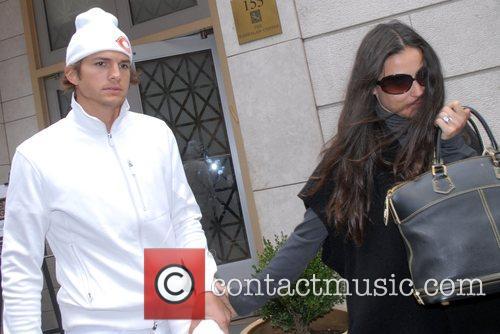 Ashton Kutcher and Demi Moore attending a Kabbalah...