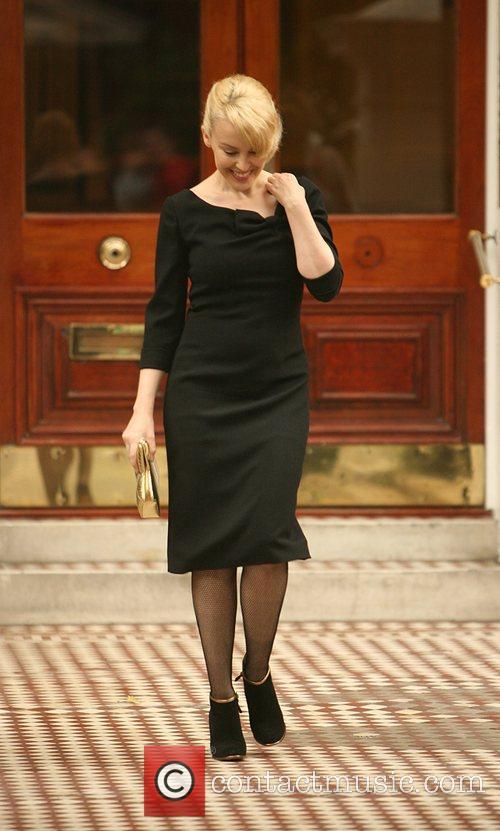 Looking very elegant as she leaves home in...
