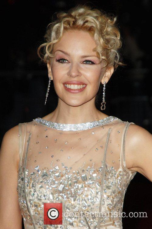 * MINOGUE CLAIMS OBE ON QUEEN'S HONOURS LIST...