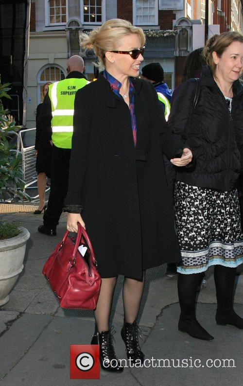 Kylie Minogue leaves Getti restaurant signing for fans...