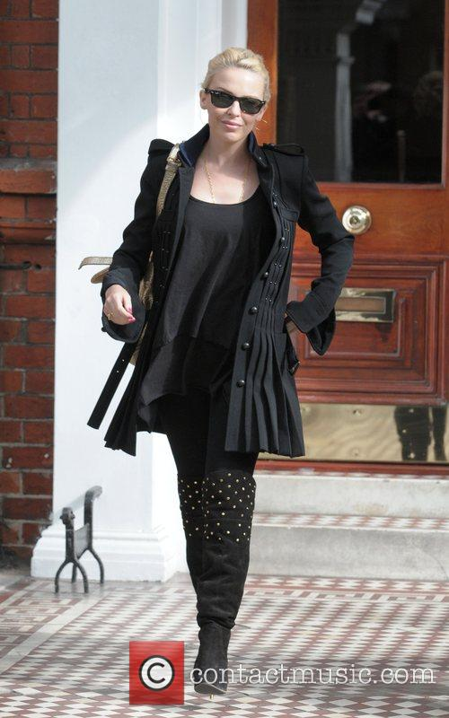 Leaving her home wearing studded, over-the-knee boots