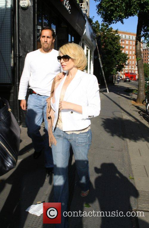 Kylie Minogue is escorted out of her car...