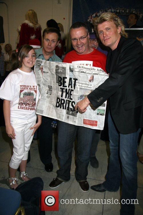 Hans Klok and Alan Rothwell with family Press...