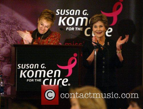 Delivers a speech at a Breast Cancer benefit...
