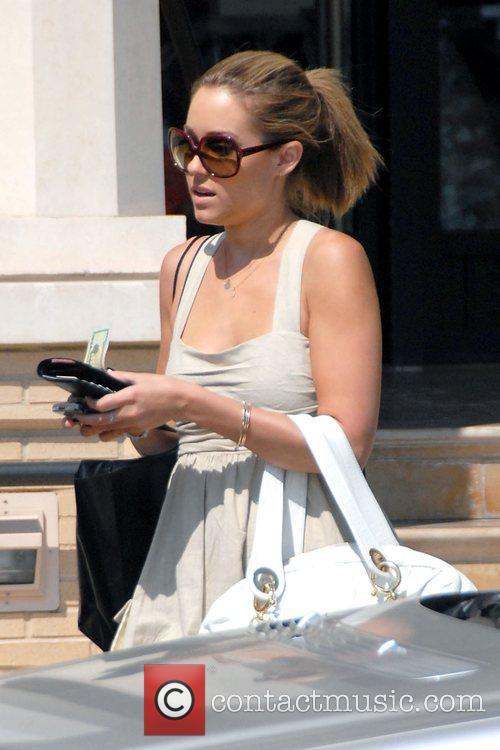 The Hills star Lauren Conrad leaving Barneys New...