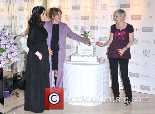 Emma Thompson offers some flowers to Annie Lennox...