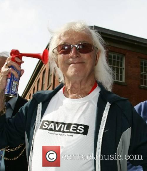 Jimmy Saville  launches the Leeds 10k race...
