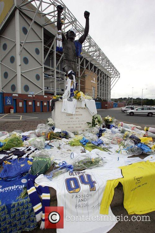 Leeds United fans lay flowers and football shirts...