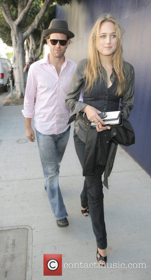 Leelee Sobieski and her boyfriend walk to their...