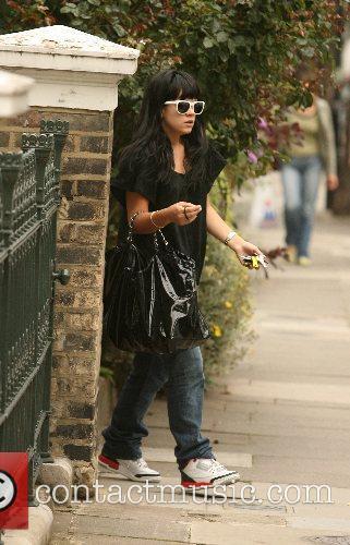 Lily Allen leaving her boyfriend's home to prepare...