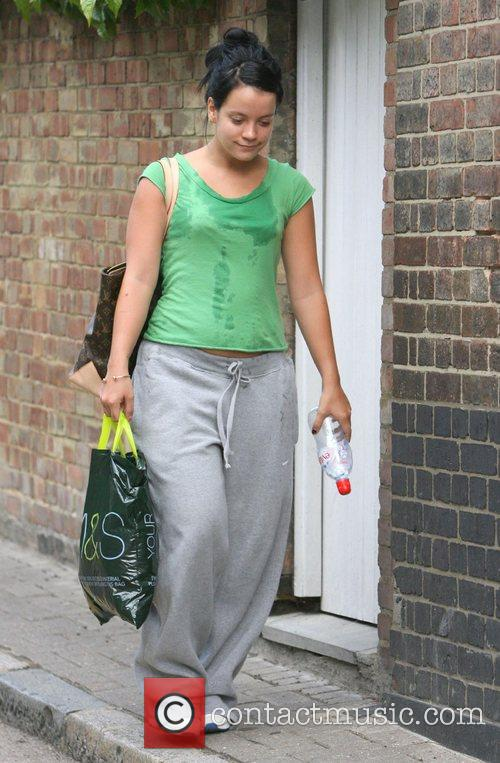 Leaving her gym looking very tired and sweaty