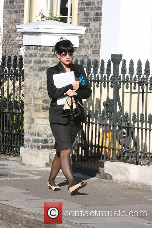 Lily Allen Clutching her new Air MacBook as...