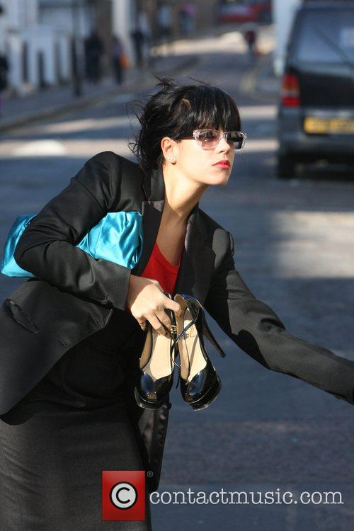 Lily Allen Clutching her new Air MacBook and...