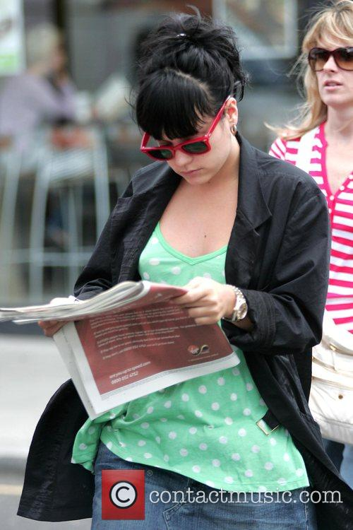 Reads a newspaper as she enjoys a relaxing...