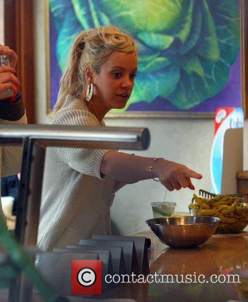 Lily Allen grabs a bit to eat from...