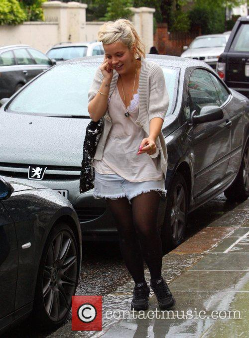 Lily Allen talks on her mobile as she...