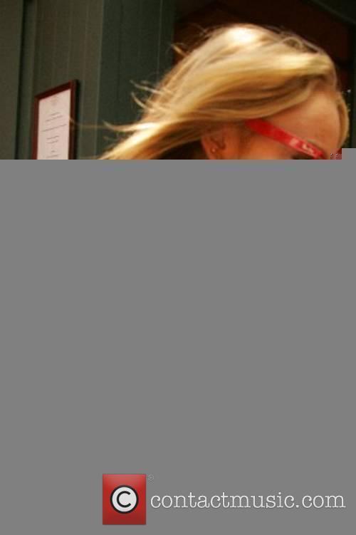 Lindsay Lohan leaves a restaurant after having lunch...
