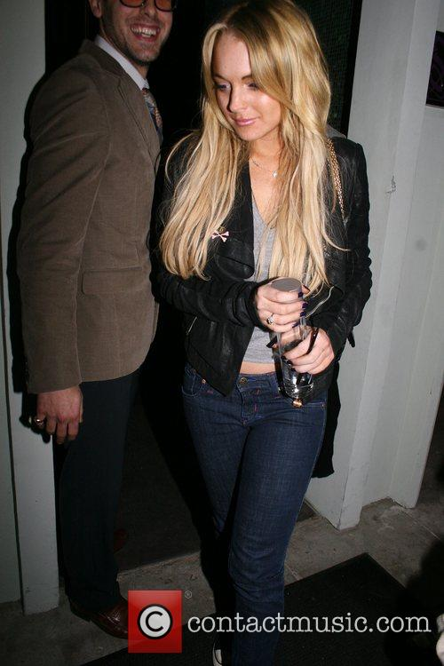 Lindsay Lohan leaving Foxtail restaurant