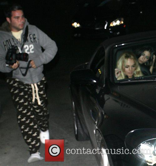Lindsay Lohan is photographed by a paparazzi photographer...