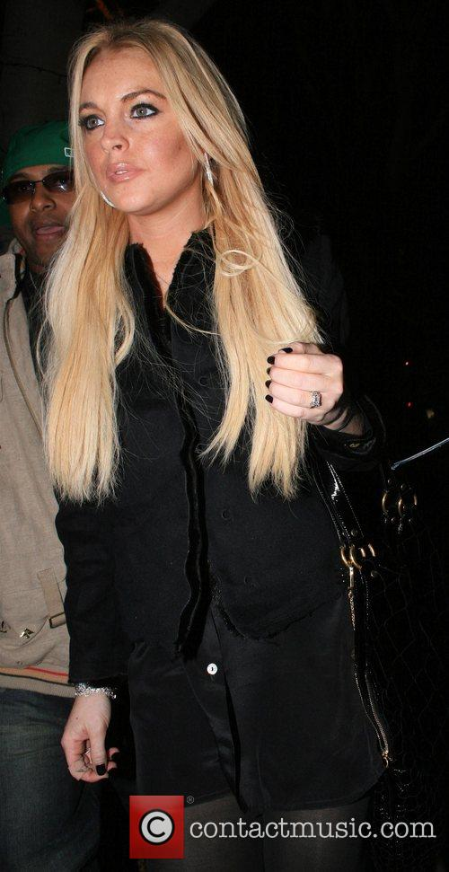 Lindsay Lohan leaving Madeo restaurant after dining with...