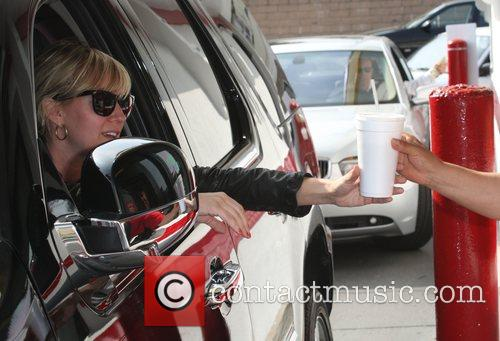 Lindsay Lohan arrives at a McDonalds drive-thru window...