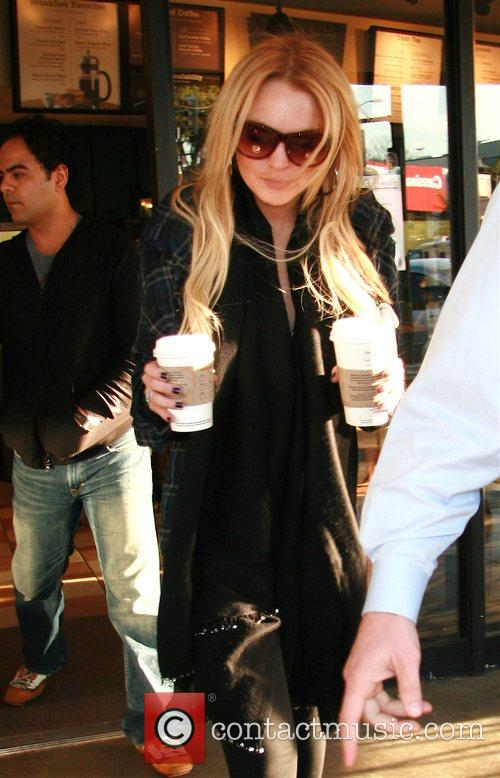 Lindsay Lohan picks up two large coffee at...
