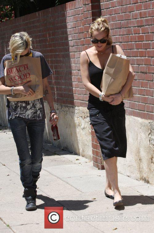 Samantha Ronson and Lindsay Lohan carry groceries back...