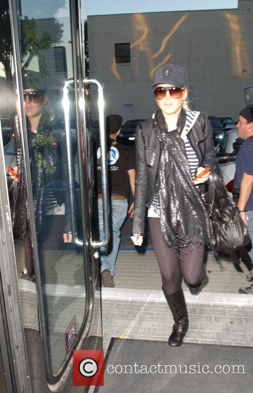 Lindsay Lohan dressed in black leaving the Hermes...