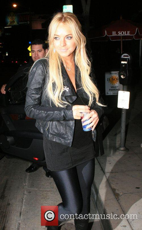 Lindsay Lohan drinking an energy drink while arriving...
