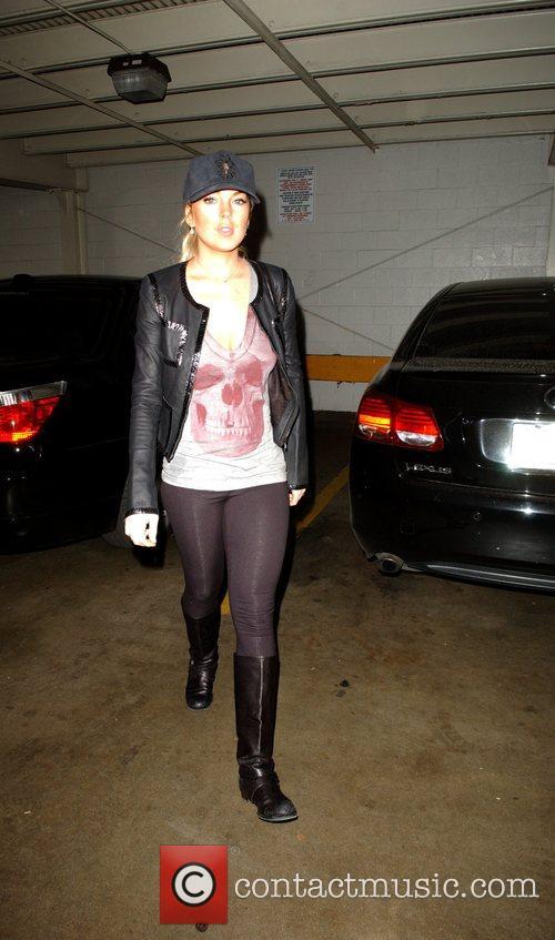 Lindsay Lohan parks her car to go shopping...